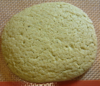 Photo of a single matcha green tea cookie.