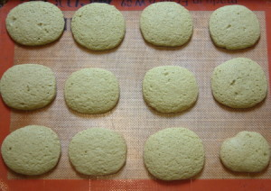 Photo of twelve freshly baked matcha green tea cookies.