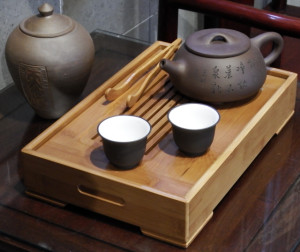 Traditional teapot, cups, and tray.