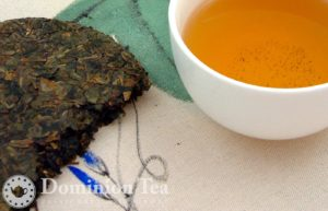 View inside an aged oolong tea cake and its brew.